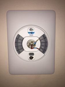 Nest thermostat with wires attached